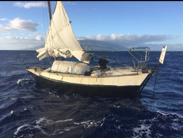 The Coast Guard, and a good Samaritan assisted a 62-year old Australian mariner in his homemade sailing vessel three and a half miles west of the Keehi Harbor, Maui, Jan 1, 2018. A 45-foot Response Boat-Medium boatcrew from Coast Guard Station Maui safely towed the 30-foot sailing vessel Kehaar Darwin to Sugar Beach, Maui. (U.S. Coast Guard video/Released)