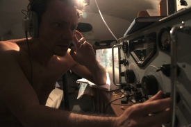 Donald Crowhurst (Justin Salinger) on radio transmitter