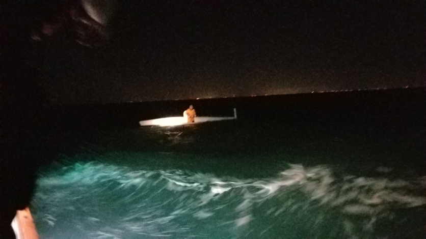 A Coast Guard 29-foot Response Boat-Small II boatcrew from Station Fort Myers Beach rescues Fort Walton Beach native, Randy Smyth, from his capsized 20-foot trimaran sailboat 12 miles south of Sanibel Island, March 3, 2018. Smyth was participating in the Water Tribe Everglades Challenge, a boat race spanning from St. Petersburg to Key Largo. (U.S. Coast Guard photo.)