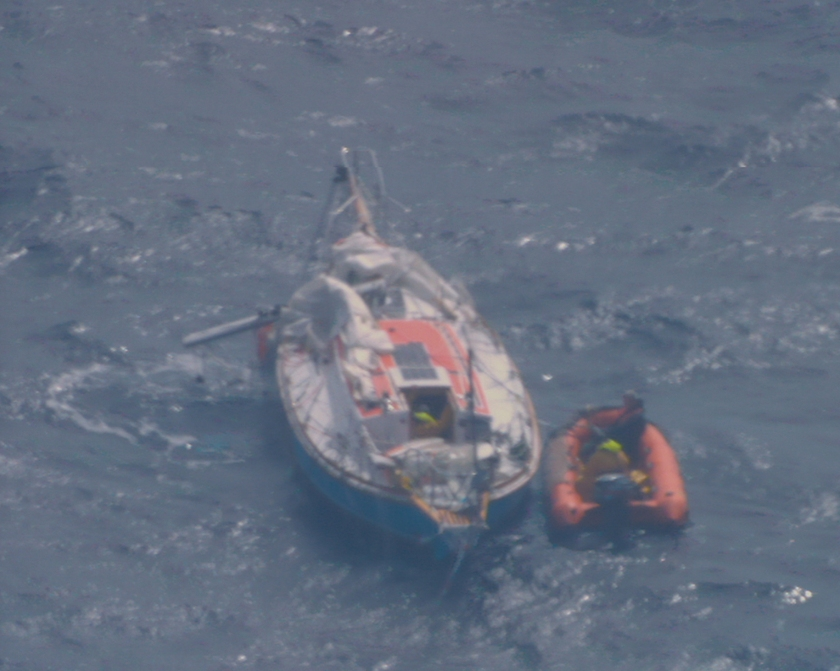 2018 Golden Globe Race. Crew from the French Fisheries Patrol ship OSIRIS  board Abhilash Tomy's dismasted yacht  THURIYA to rescue the injured yacht yachtsman. Photographed from the Indian Navy P8i reconnaissance aircraft operating out of Mauritius.
